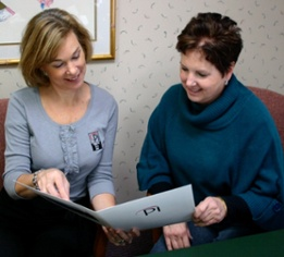 Patient discusses dental treatment plan with Pi Dental Center patient relations coordinator