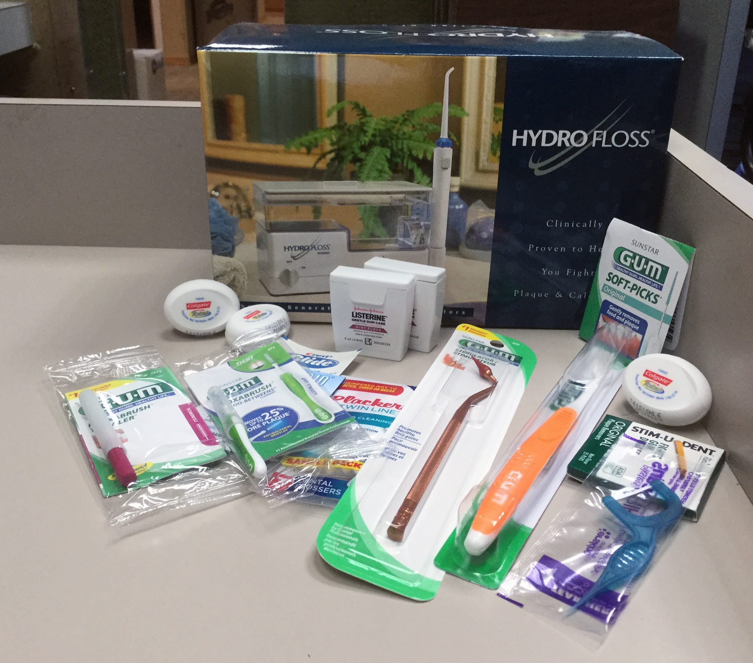 Daily oral hygiene home care can include dental floss, oral irrigators, proxabrushes