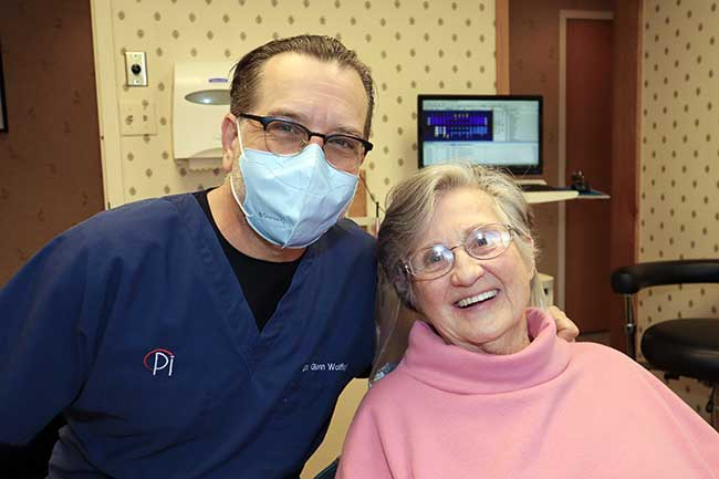 Dr. Glenn Wolfinger with patient who received Zirconia crowns