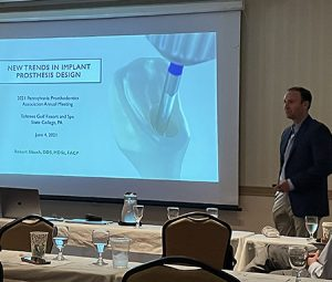 Dr. Slauch lecturing about dental implant prosthesis design